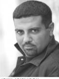 John Abiskaron profil resmi